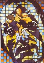 Vitrail du visage de Saint Jean de Dieu avec l'image incluse des enfants à sauver.