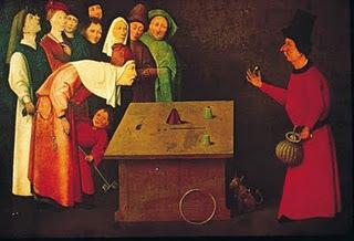 """""""L'Escamoteur aurait été peint entre 1475 et 1480. C'est une œuvre qui se moque de la stupidité, de la naïveté du peuple. Elle se classe dans les tableaux à scènes moralisatrices. Sur ce tableau, une dizaine de personnes sont regroupées sur la partie gauche pour admirer les tours de passe-passe d'un prestidigitateur situé lui seul, à droite du tableau. Il tient une perle entre le pouce et l'index ; l'un des spectateurs la regarde attentivement, plié en deux. Si celui-ci était redressé, il dépasserait d'une tête les autres personnages. On peut voir une grenouille entre ses lèvres et une autre sur la table. La perspective de la table s'accorde assez mal avec le reste du tableau. Profitant de l'attention que porte le spectateur au charlatan, un moine qui se situe derrière le spectateur fait mine de regarder ailleurs pendant qu'il lui dérobe sa bourse bien remplie."""" (source :Vivat.be)"""