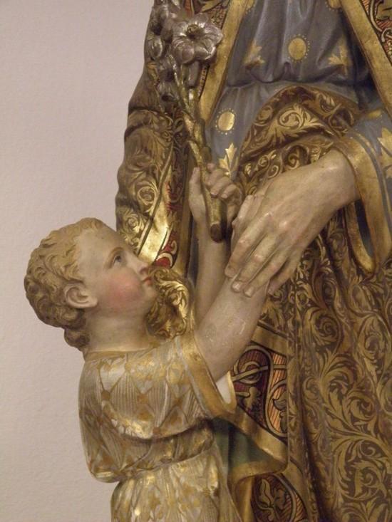 L'enfant Jésus tend à Joseph l'insigne trinitaire.